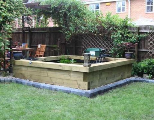 Pond water feature with railway sleepers for Raised pond design