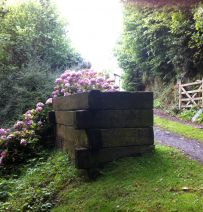 Rubbish bin enclosure from used railway sleepers