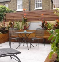 Fiona's beautiful courtyard garden with new oiled railway sleepers