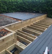 Sam Broadhurst's decking & raised beds with railway sleepers