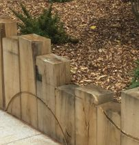 Jane's stylish routed railway sleeper retaining wall