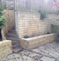 Jon Adsetts retaining wall and raised bed with new railway sleepers