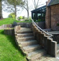 Kingfisher steps, wall & patio with railway sleepers