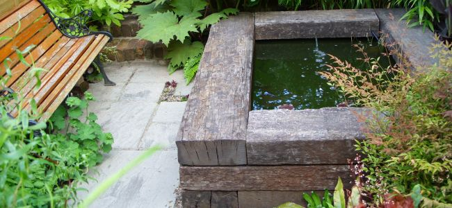 Pond water feature with railway sleepers for Garden pond design using sleepers